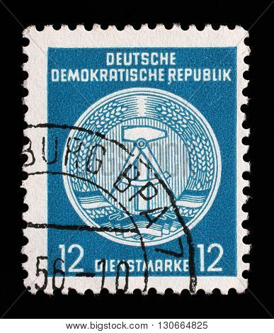 ZAGREB, CROATIA - SEPTEMBER 13: A Stamp printed in GDR (German Democratic Republic) shows GDR coat of arms, series GDRs national coat of arms, circa 1952, on September 13, 2014, Zagreb, Croatia