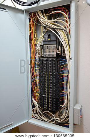 Breaker box with circuit-breakers and tangled cable leads