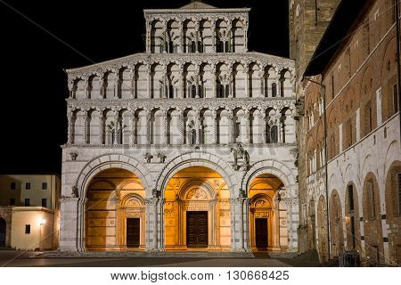 Lucca Cathedral or Duomo di San Martino in the Tuscan village of Lucca Italy photographed at night. The cathedral dates to the 13th century.