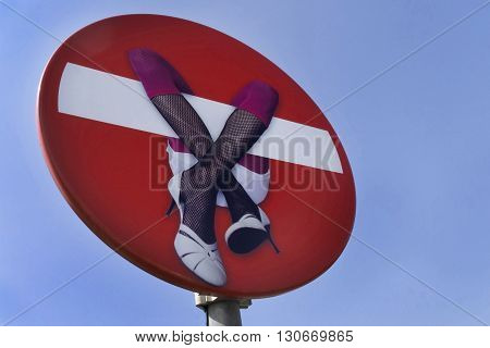 red stopsign in blue sky with a woman on it