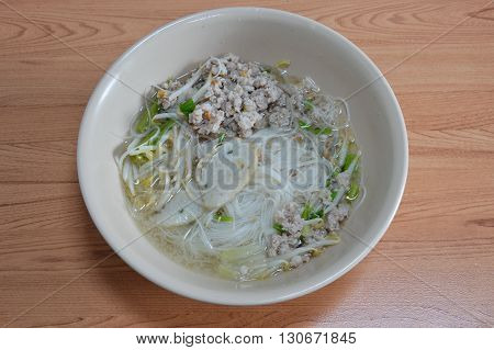 rice vermicelli topping fish line and boiled chop pork in soup