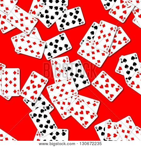 seamless pattern texture background with playing cards irregularly scattered on the red table