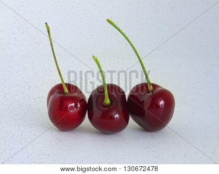 Ripe red cherry isolated on brindle spots background