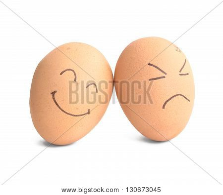 smiley and angry egg on white background