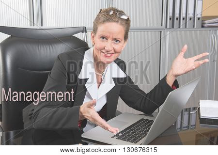 female chef in the office likes results - smiling