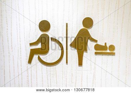 Logo icon of the toilet for disability and baby changing room