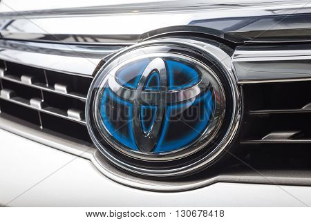BANGKOK, THAILAND - MAY 20, 2016 : Toyota logo on Toyota Camry hybrid 2016 model, one of the most successful hybrid car from Japanese automobile manufacturer