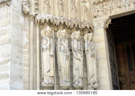 Detail of facade of the church Notre Dame of Paris - France