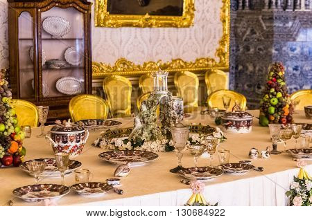 TSARSKOYE SELO, RUSSIA - MARCH 12: Antique dinner table in Catherine Palace at March 12, 2016 in Tsarskoye Selo (Pushkin), Russia