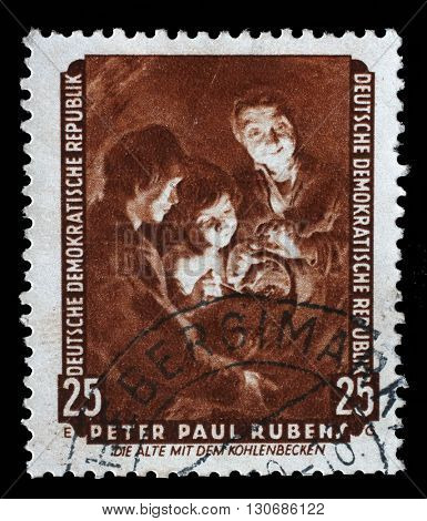 ZAGREB, CROATIA - SEPTEMBER 13: stamp printed in DDR shows the painting Old woman with a brazier, by Rubens, series Famous Paintings from Dresden Gallery, 1957, on September 13, 2014, Zagreb, Croatia