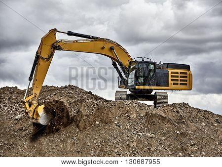 Constuction Industry Excavator Heavy Equipment Digging On Gravel Hill