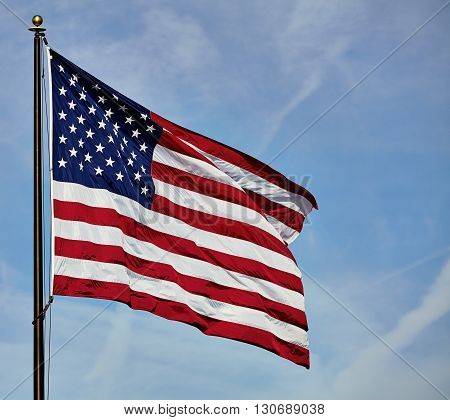 Flag Usa Fluttering In Wind On Sky And Clouds