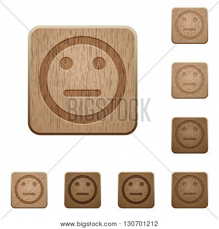 Set of carved wooden Neutral emoticon buttons in 8 variations.