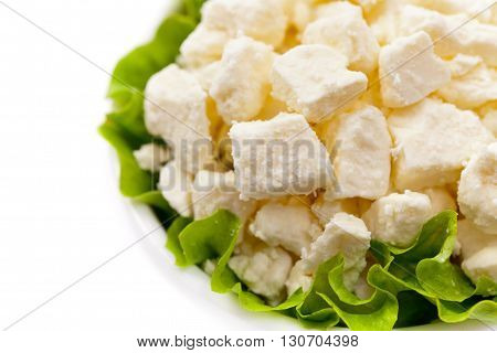 Feta Crumbled Cheese Isolated on White. Selective focus.