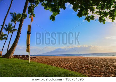 Luxurious Lahaina beach coastline found in Maui showcasing lifeguard floatation device.