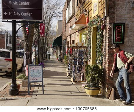 Brevard North Carolina USA - December 11 2015: Laid back downtown street in the small town of Brevard North Carolina in winter before Christmas on a sunny day December 11 2015 in downtown Brevard NC