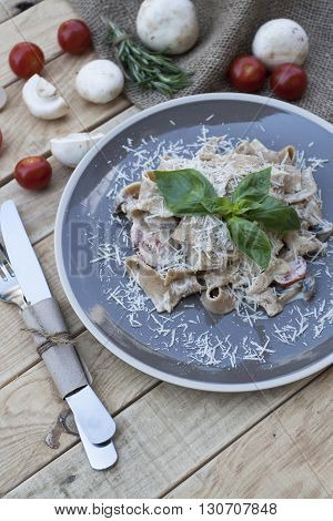 A Vegetarian Pasta With Mushrooms And Cherry Tomatoes, Parmesan And Basil
