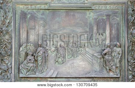 PISA, ITALY - JUNE 06, 2015: Presentation of the Virgin in the Temple, detail of central bronze door on the right of the Cathedral St. Mary of the Assumption in Pisa, Italy on June 06, 2015