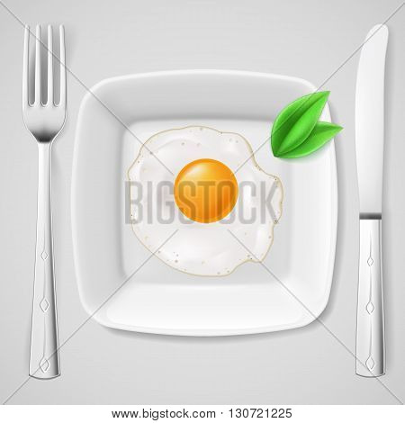 Served breakfast. Fried egg on white plate served with fork and knife