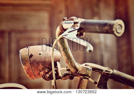 Old bicycles parked a rusted and near disintegrated.