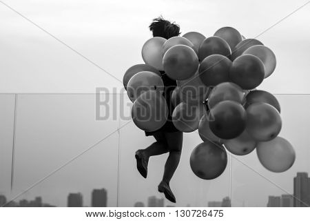Silhuette Happy Lady Jumping With Boubble