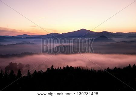 Misty Daybreak In A Beautiful Hills. Peaks Of Hills Are Sticking Out From Foggy Background, The Fog