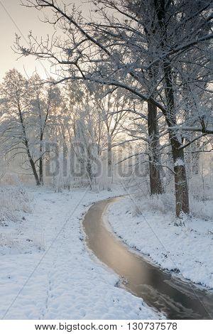 Arch of frozen river in snowy winter morning, Podlasie Region, Poland, Europe