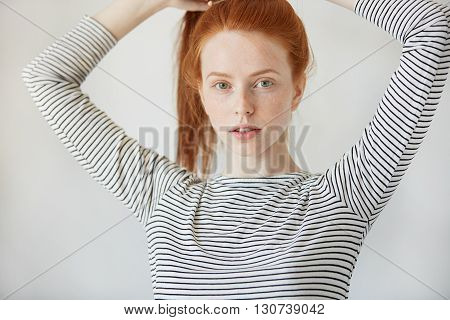 Beautiful Caucasian Young Woman With Healthy Freckled Skin Looking And Smiling With Thoughtful Expre