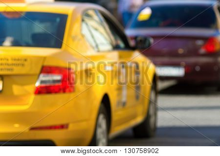 unsharp photo closeup of the car of a yellow taxi on the street city for industrial indistinct background