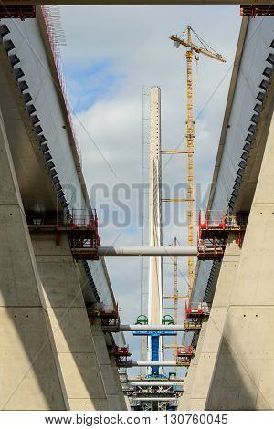 SOUTH QUEENSFERRY SCOTLAND UK - MAY 15 2016: Construction at the southern tower of The Queensferry Crossing a new road bridge spanning the River Forth in Scotland.