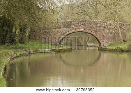 An image showing an old bridge over the Grand Union Canal shot at Laughton Hills Leicestershire England UK.
