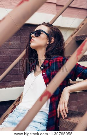 Hipster Girl On Metal Stairs.