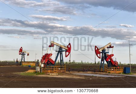 pump for pumping oil three red white.