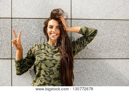 Happy Girl In Front Of Stone Wall
