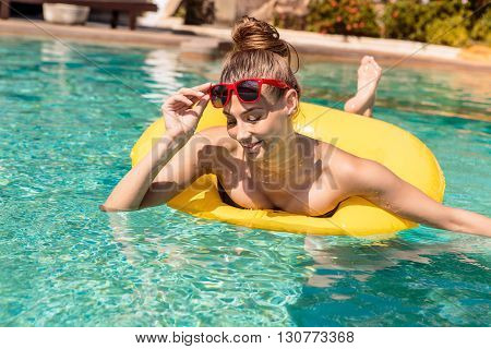 Sexy Girl With Yellow Ring At Pool Party