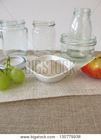 Agar agar, jars and fruits on table
