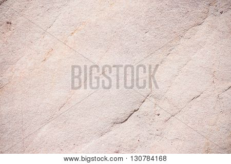 Sedimentary rock fine grained omogeneous sandstone with fractures and alteration pattern. Natural background pattern and texture light gray color.