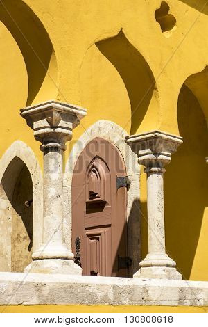 A small architectural detail of the Pena Palace in Sintra Portugal shows some of the distinctive features of arches and columns.