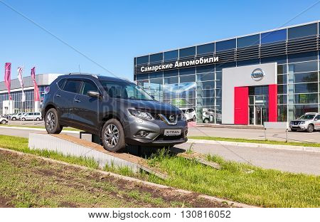 SAMARA RUSSIA - MAY 14 2016: Demonstration car Nissan X-Trail parked up near the office of official dealer Nissan. Nissan is a Japanese multinational automotive manufacturer