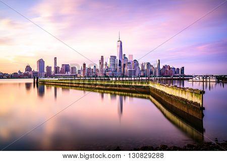 Beautiful sunrise view of Downtown Manhattan shot from Jersey City
