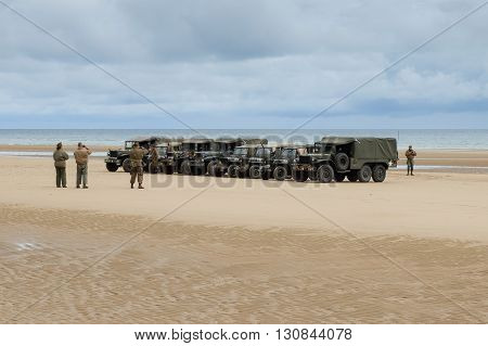 Omaha Beach, France, June 4th 2014: people and military vehicles at Omaha beach to celebrate the anniversary of d-day allied debarquement in Normandy.