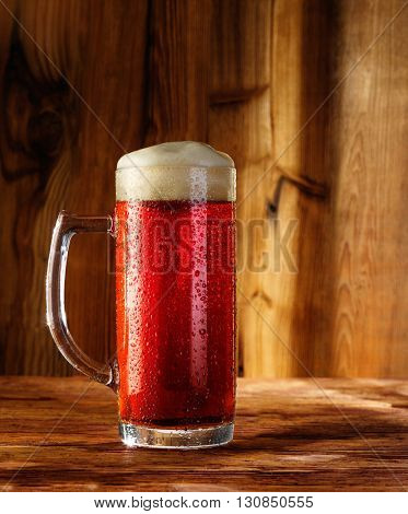 cherry beer on a wooden background