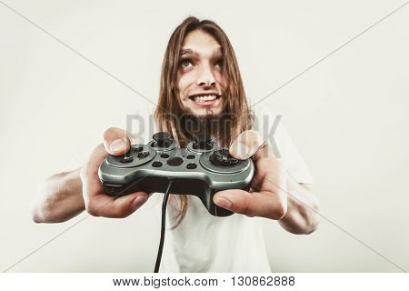 Stressed Man Playing On Pad