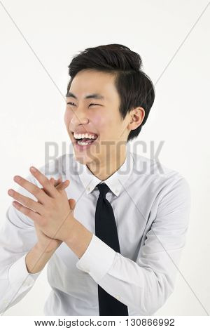 Successful asian businessman burst out laughing isolated on white background