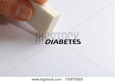 Diabetes word with eraser on white paper background