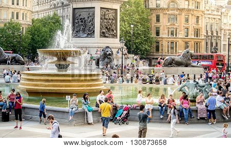 London, England - JULY 27, 2014 - Busy touristic Trafalgar square in central London, England. Trafalgar square is an important historic and touristic place in central London.