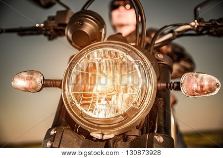 Motorcycle on the road motorcycle headlamp closeup