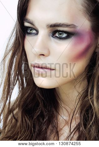 young beauty woman with makeup like shiner on face close up isolated white background, lifestyle people concept