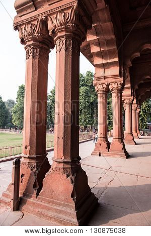 Beautifully sandstone architectured pillars inside the Red Fort in Delhi. Red Fort was the residence of Mughal Emperors and boasts of jaw-dropping mughal architecture.