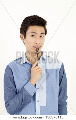 Asian man with fork isolated on white background